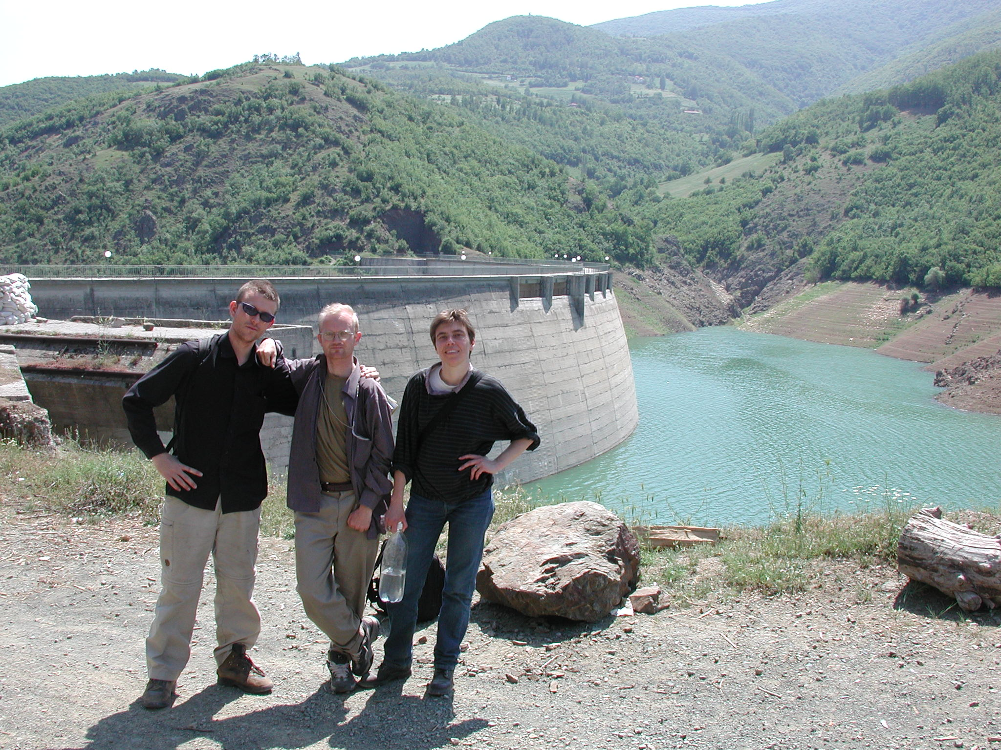 Three journalists from the Netherlands, Denmark and Norway marching from Macedonia to Kosovo to avoid the fighting.