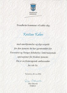 English translation: The city of Trondheim would like to thank you, Kristian Kahrs, with recognition and deep respect the the service you have done for the Norwegian Armed Forces and Norway's participation in international operations in the service of peace. You are an excellent ambassador for our city. Trondheim, May 28, 2014, Rita Ottervik, Mayor.